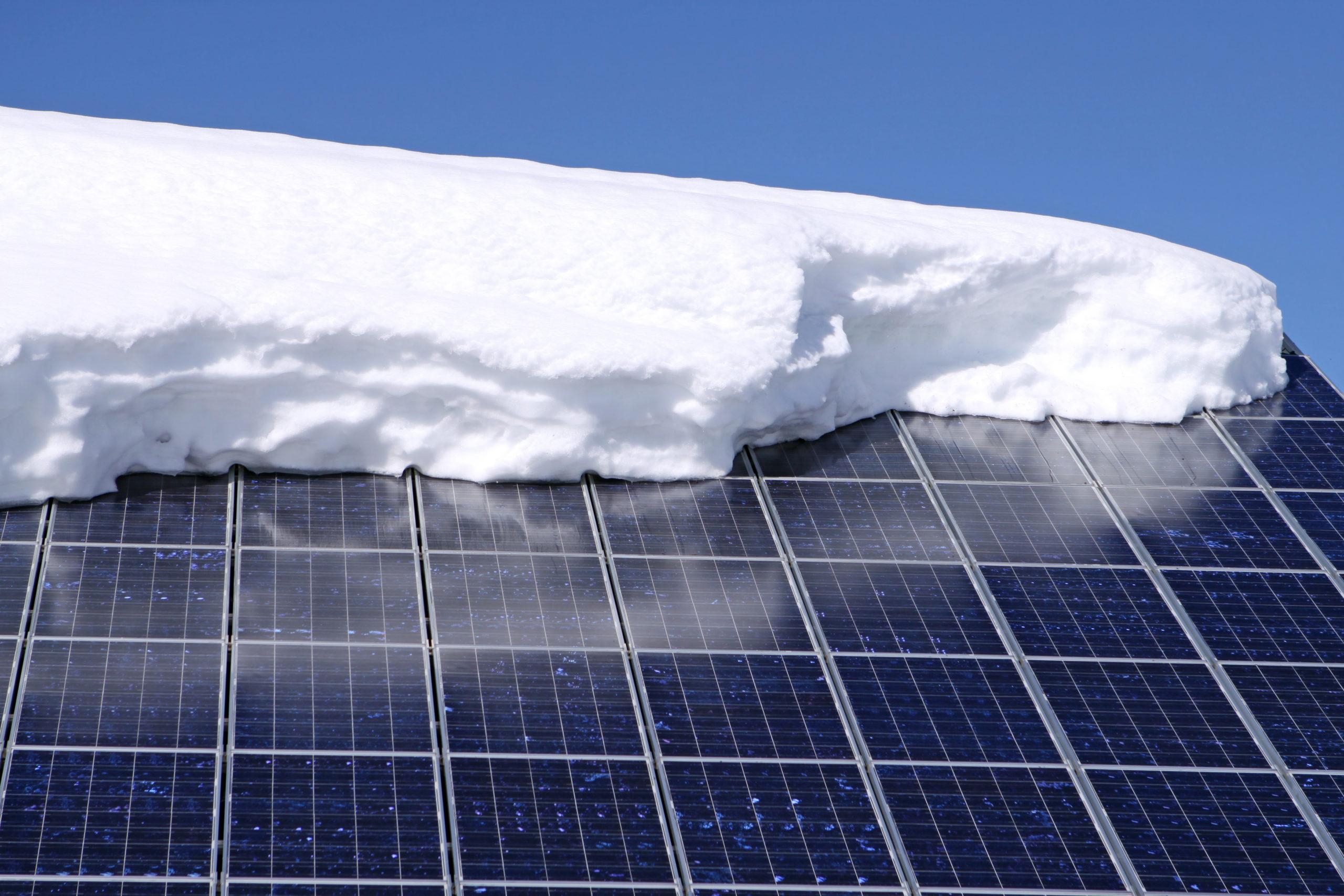 solar panels with snow