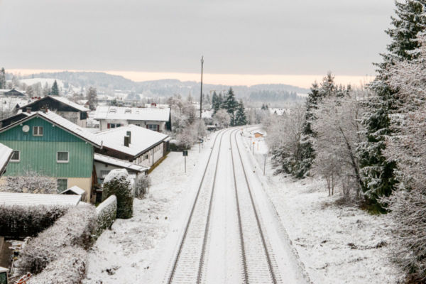 Snow-covered,Tracks,With,Green,Houses